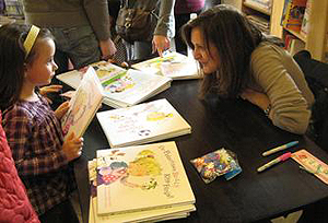 Carmela Signs Books